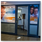 Entrance signs for Dr Nowak's Dental Office in downtown Calgary.